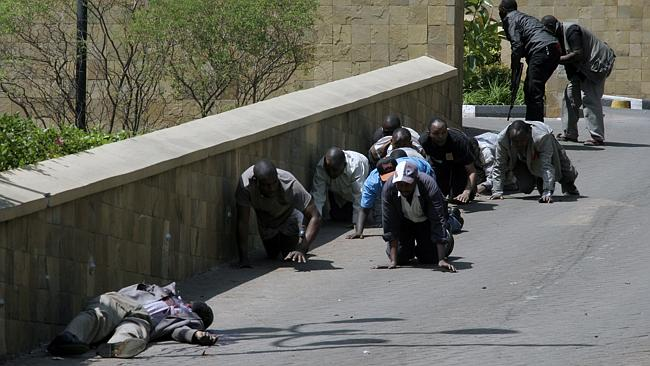 A body, left, lies outside the Westgate Mall in Nairobi, Kenya following an attack by armed Islamic extremist group al-Shabab. Picture: AP
