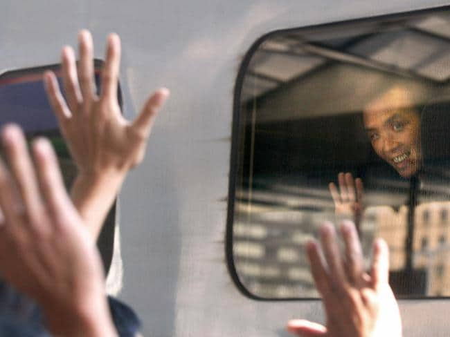 On home ground ... Kaoru Hasuike returnes to Japan for the first time and waves to wellwishers as he leaves Tokyo railway station. Picture: Supplied.