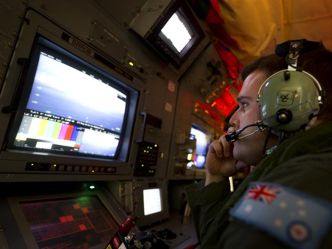Search ongoing ... Royal Australian Air Force (RAAF) airborne electronics analyst Sergeant Samuel Carson used the advanced camera systems on board an AP-C3 Orion aircraft to search for evidence of Malaysia Airlines flight MH370 over the southern Indian Ocean this year.