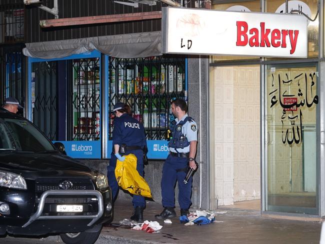 Police establish their crime scene in Auburn overnight. Picture: Bill Hearne