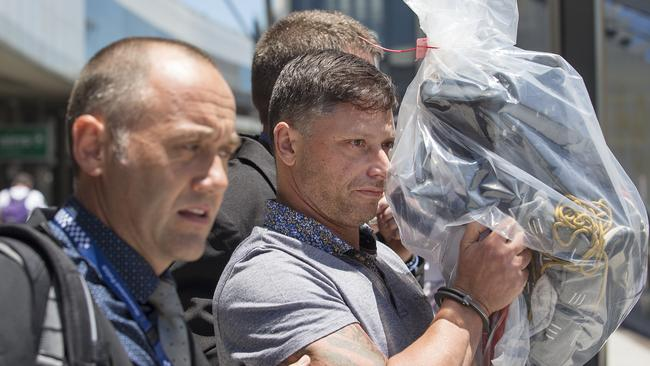 Queensland police detectives escort adult shop owner David Piccinato to Brisbane last month to face charges of possessing synthetic cannabis. Pictures: Jack Tran