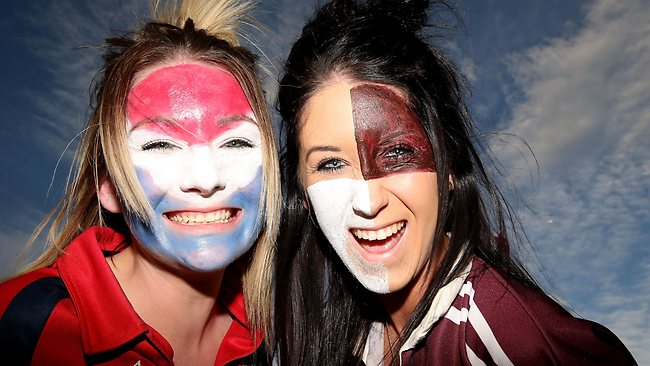 Roosters and a Sea Eagles fans show their support before the 2013 NRL Grand Final.