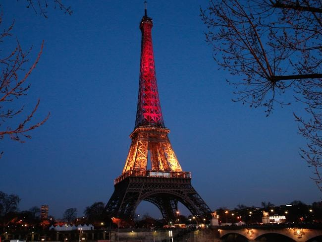 The Eiffel Tower is illuminated with the Belgium national colours black, yellow and red. Picture: Thibault Camus/AP Photo