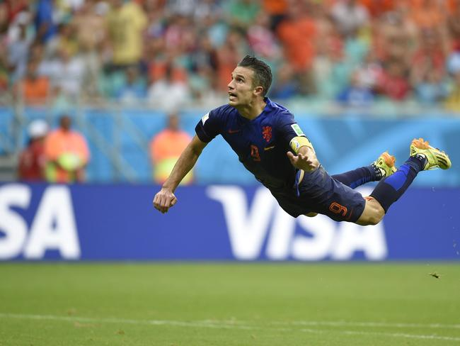 Using his head ... Netherlands' forward Robin van Persie scores during a Group B football match between Spain and the Netherlands.