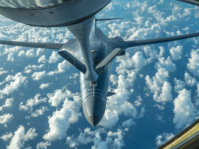 A US Air Force B-1B Lancer receives fuel from a KC-135 Stratotanker during a 10-hour mission from Andersen Air Force Base, Guam, into Japanese airspace and over the Korean Peninsula on July 30. Picture: AFP/US Air Force/Kamaile Casillas