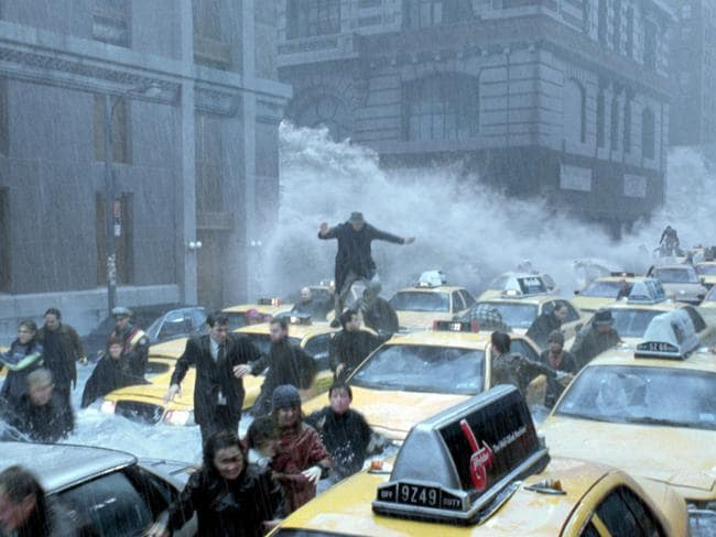New Yorkers run for their lives as a tsunami floods the streets of New York City in 'The Day After Tomorrow'.