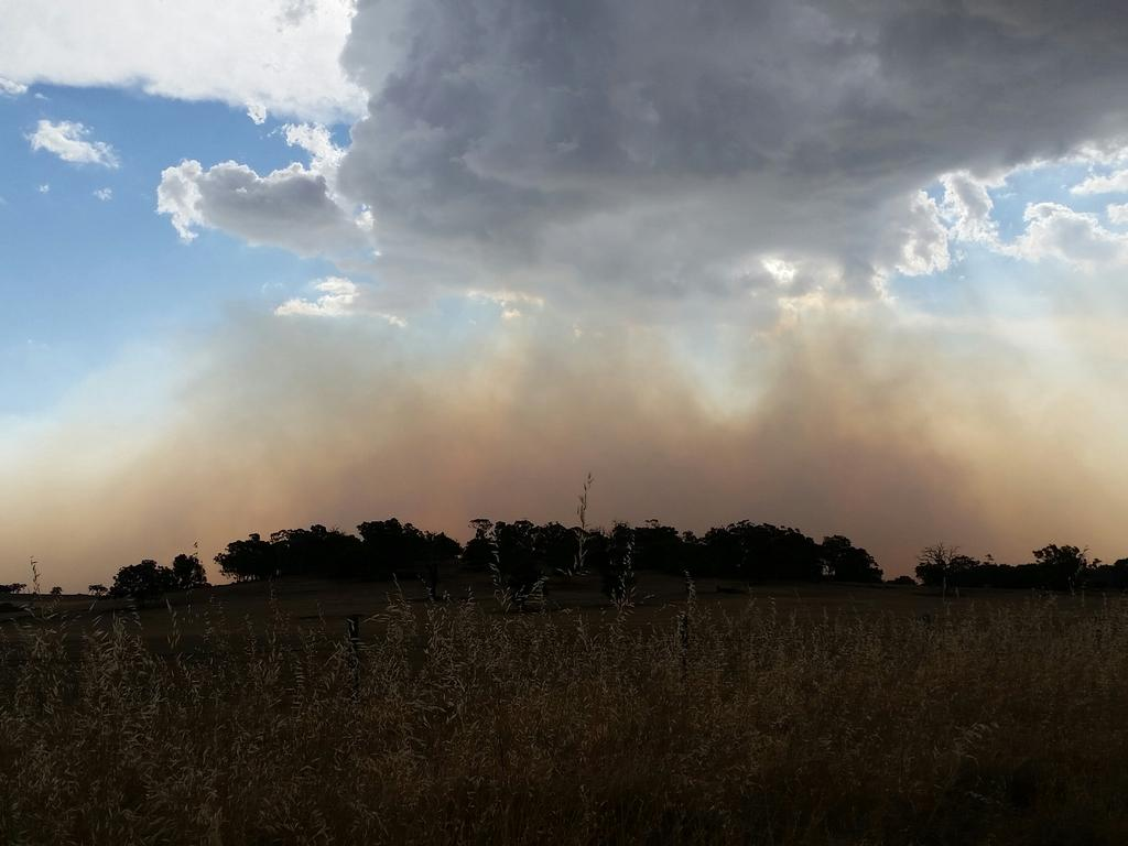 Waroona / Yarloop Bushfires. Huge ink black storm clouds, and extreme velocity winds due to a storm cell. Williams had a loss of power. This image was taken looking across from Williams to Harvey fire storm. Taken on Albany Highway. PICTURE: JANE WISHAW.