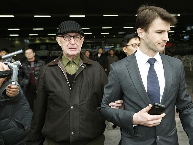 John Short leave walks the Beijing International Airport terminal after his release from North Korea. Picture: AP