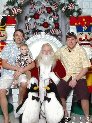 2012 ... Mike and Martin hope to indefinitely continue their Santa photo tradition. Picture: Martin Gray