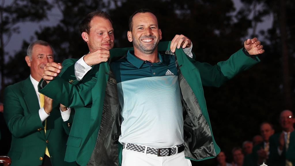 Danny Willett presents Spaniard Sergio Garcia with the green jacket after Garcia won in a playoff during the final round of the 2017 Masters Tournament at Augusta National Golf Club. Picture: David Cannon