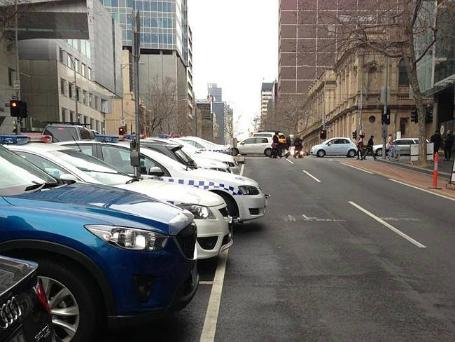 Nosing out: a police vehicle spotted on Lonsdale St. Picture: Facebook/Melbourne Crap Parkers