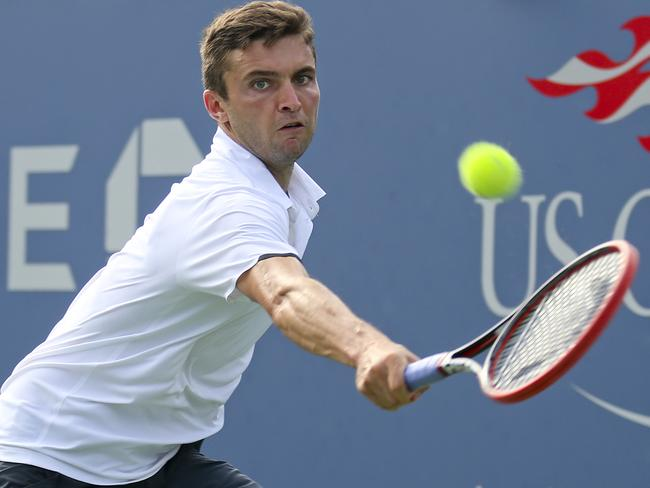 Marin Cilic returns a shot to Gilles Simon during the fourth round of the 2014 U.S. Open.