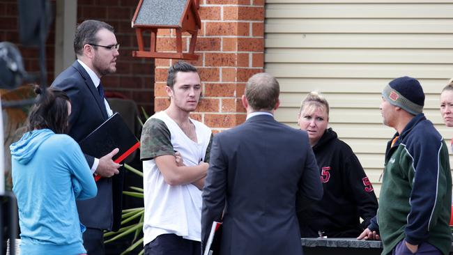 Detectives interview neighbors after a fatal home invasion at Badgerys Creek. Picture: Cameron Richardson.