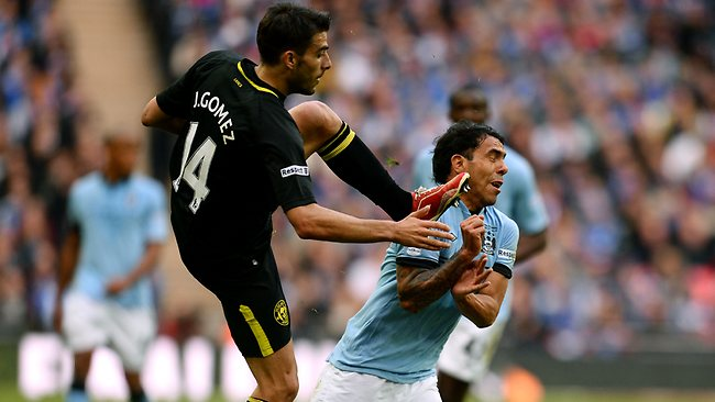 FA CUP FINAL. Wigan Athletic 1 d Manchester City 0 at Wembley. Jordi Gomez of Wigan Athletic challenges Carlos Tevez. Picture: Mike Hewitt