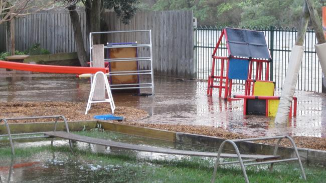 The play equipment is surrounded by water after the mighty deluge. Picture: Supplied