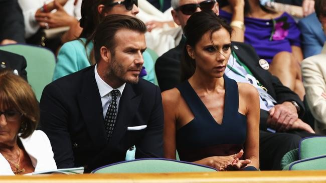 Becks and Posh were captivated by the epic men's final between Roger Federer and Novak Djokovic. Photo: Matthew Stockman.