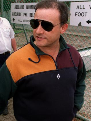 NCA bombing suspect Domenic Perre leaves the Adelaide Pre-Release Centre in 2001, after being jailed over a meth lab in 1997.