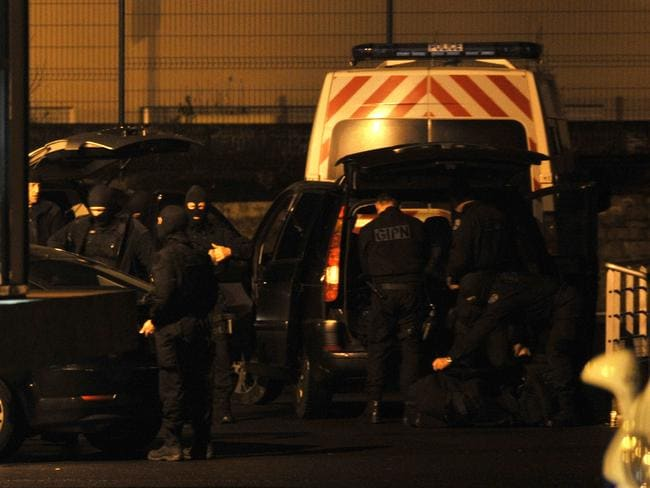 French national police intervention group officers gather at Charleville Mezieres police station during a massive manhunt for the Kouachi brothers.