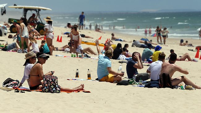 2/12/12 People gather to enjoy the day on Surfers Paradise Beach. Pics Adam Head Picture: Adam Head