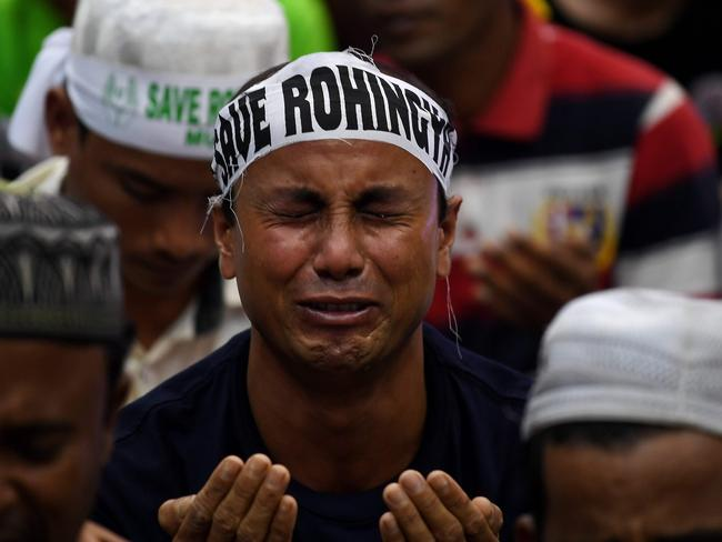 An ethnic Rohingya Muslim refugee breaks down during a gathering in Malaysia against the persecution of Rohingya Muslims in Myanmar. Picture: Manan Vatsyayana/AFP