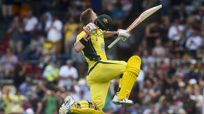 Batsman Dave Warner of Australia celebrates his century during the second One Day International between Australia and New Zealand at Manuka Oval in Canberra, Tuesday, Dec. 6, 2016. (AAP Image/Lukas Coch) NO ARCHIVING, EDITORIAL USE ONLY, IMAGES TO BE USED FOR NEWS REPORTING PURPOSES ONLY, NO COMMERCIAL USE WHATSOEVER, NO USE IN BOOKS WITHOUT PRIOR WRITTEN CONSENT FROM AAP
