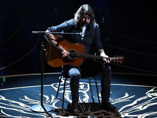 Dave Grohl performs during the memorial reel.