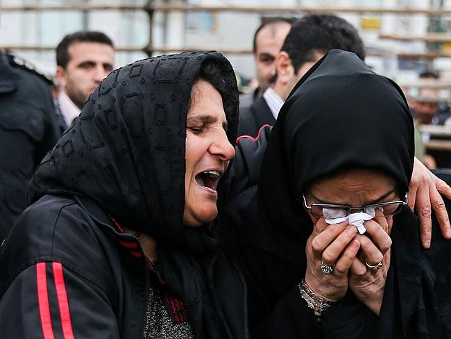 United in grief ... The killer's mother, left, cries with the victim's mother after she decided to spare the life of her son's killer with an emotional slap to the face at the gallows. Picture: AFP/ARASH KHAMOOSHI/ISNA