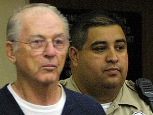 The Reverend Paul Shanley (L) is led for a extradition hearing into a courtroom by a San Diego County Sheriff's deputy 03/05/02, in San Diego. Shanley, who is at the epicenter of the clergy sex abuse scandal in the Roman Catholic Church, agreed to return to Massachusetts to face charges that he repeatedly molested a boy in the 1980s.