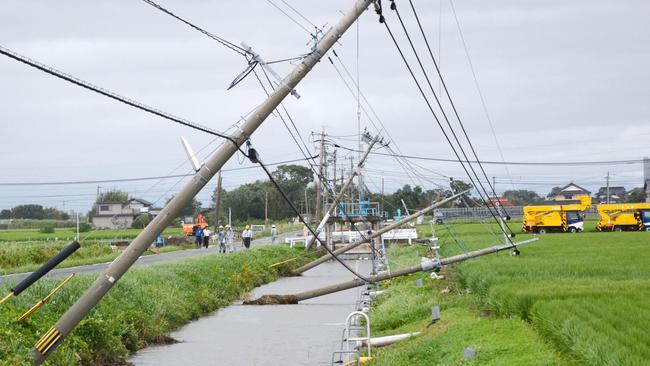 Telephone poles lean after Typhoon Goni hit Kamimine town, Saga prefecture, south-western Japan, Pic: Masahito Ono/Kyodo News via AP.