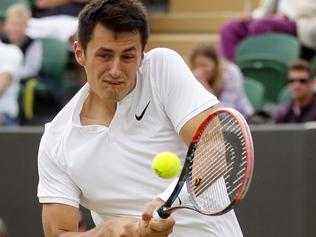 Bernard Tomic of Australia returns to Radu Albot of Moldova during their men's singles match on day four of the Wimbledon Tennis Championships in London, Thursday, June 30, 2016. (AP Photo/Tim Ireland)