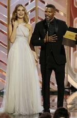 Lily James and Jamie Foxx onstage during the 73rd Annual Golden Globe Awards at The Beverly Hilton Hotel on January 10, 2016 in Beverly Hills, California. (Photo by Paul Drinkwater/NBCUniversal via Getty Images)