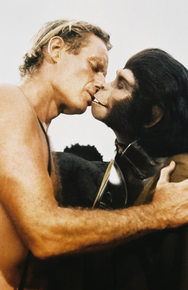 Charlton Heston kissing Kim Hunter in Planet of the Apes.