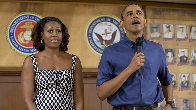 Happy couple? ... Barack and Michelle Obama during their holiday in Hawaii. Pic: Carolyn Kaster.