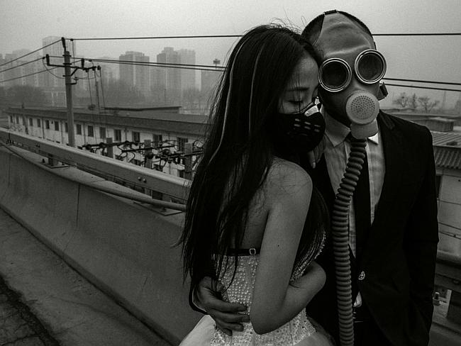 Gassed in ... The happy couple pose for a picture in central Beijing. Picture: Austral. Source: Supplied