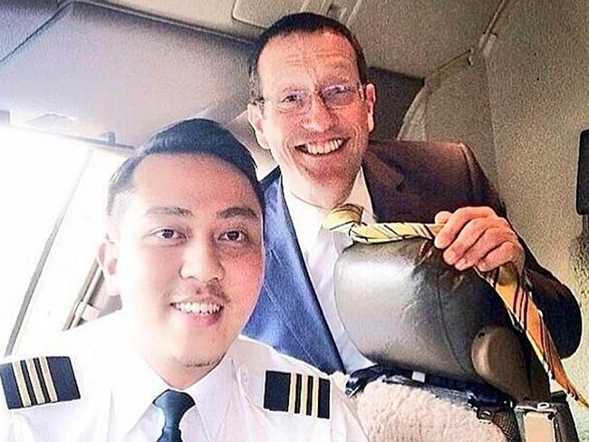 Missing ... First officer Fariq Ab. Hamid in the foreground. He joined Malaysia Airlines in 2007.