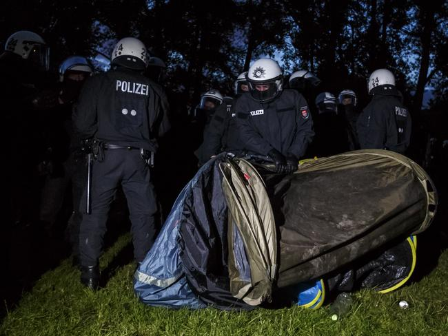 Riot police surround anti-G20 protesters and the sleeping tents the protesters had erected at a protest camp at Entenwerder Park ahead of the event that begins on Friday. Picture: Morris MacMatzen/Getty Images.
