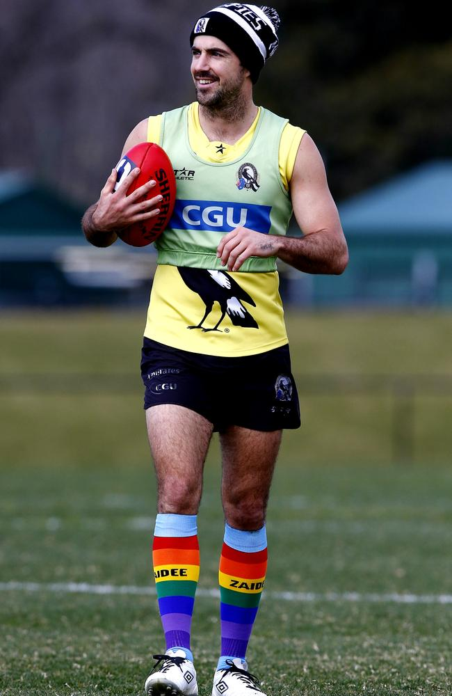 Steele Sidebottom supporting Zaidee's Rainbow Foundation by wearing rainbow-coloured socks. Picture: Wayne Ludbey