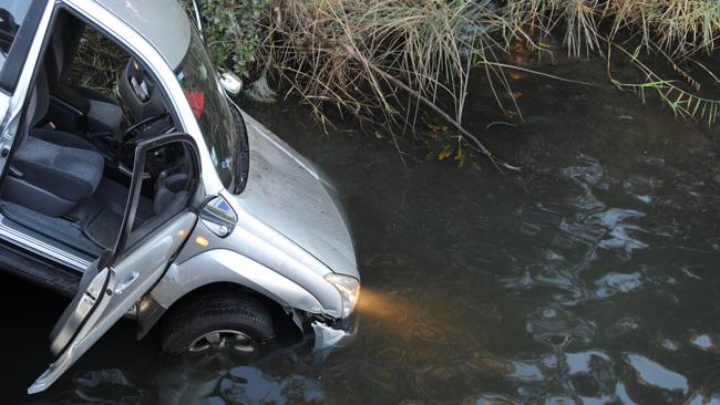 This car veered off a bridge and into a lagoon.