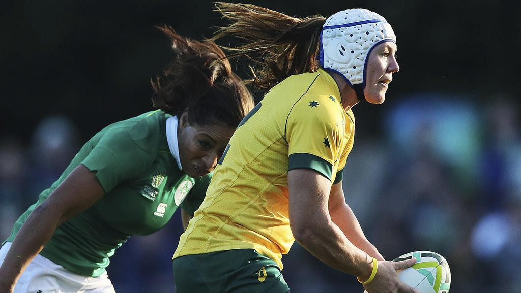 Australia's Sharni Williams and Ireland's Jenny Murphy challenge, during the 2017 Women's Rugby World Cup, Pool C match between Ireland and Australia, at the UCD Bowl, in Dublin, Wednesday, Aug. 9, 2017. (Brian Lawless/PA via AP)