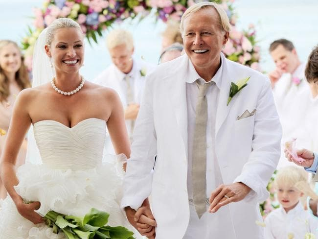 Kristy Hinze with billionaire husband Jim Clark during their wedding ceremony on the beach at the Little Dix Day Resort in the Caribbean.