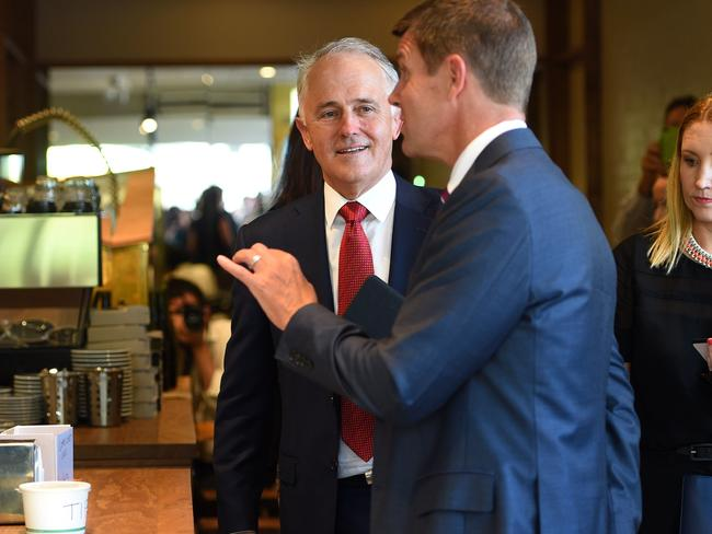 Turnbull spent time with NSW Premier Mike Baird at a bakery in Parramatta. Picture: AAP Image/Dan Himbrechts.
