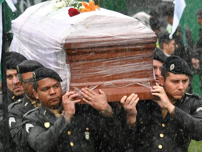 Soldiers carry the coffins of one of the members of Chapecoense Real into the stadium where a massive funeral will be held. Picture: AFP/Nelson Almeida