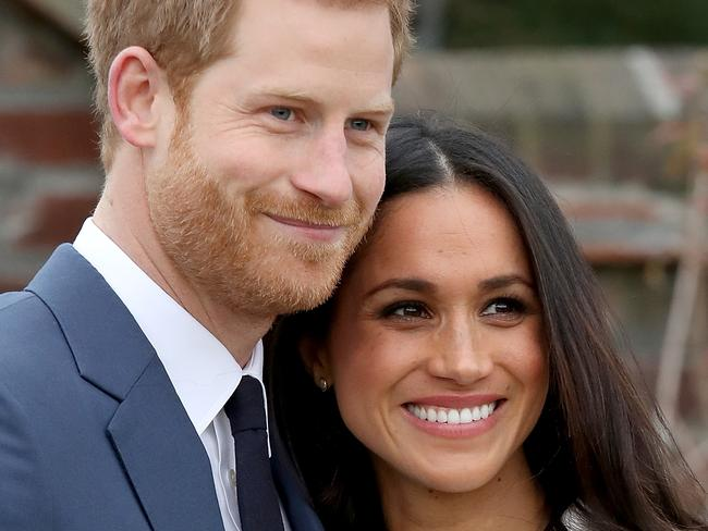 Prince Harry and Meghan Markle during an official photo call to announce their engagement at The Sunken Gardens at Kensington Palace. Picture: Getty