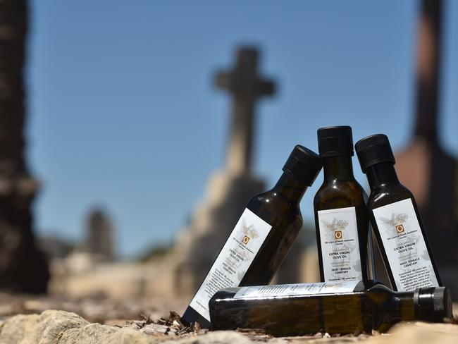 Bottles of 2017 limited edition olive oil, harvested from trees at an Adelaide cemetery to shake-up people's attitudes towards death and burial sites. Picture: AFP/Peter Parks