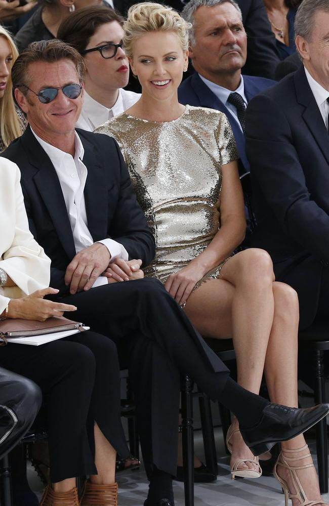 Inseparable ... Sean Penn and Charlize Theron showing affection at the Christian Dior 2014/2015 Haute Couture Fall-Winter collection fashion show in Paris.