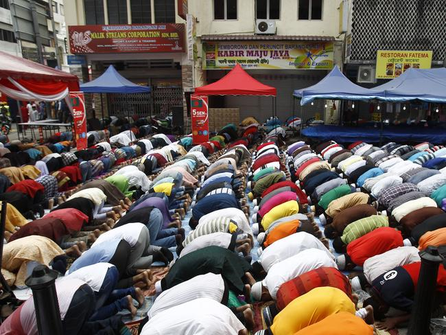 A country in mourning ... Bangladeshi Muslims living in Malaysia offer a prayer during the first day of Eid al-Fitr. Picture: Lai Seng Sin