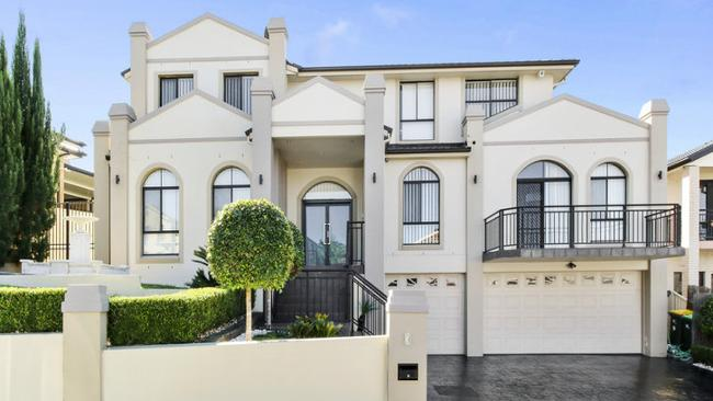 6 London Court, Cecil Hills, stands on a 785sq m block and sold $150,000 over reserve at $1.4 million.
