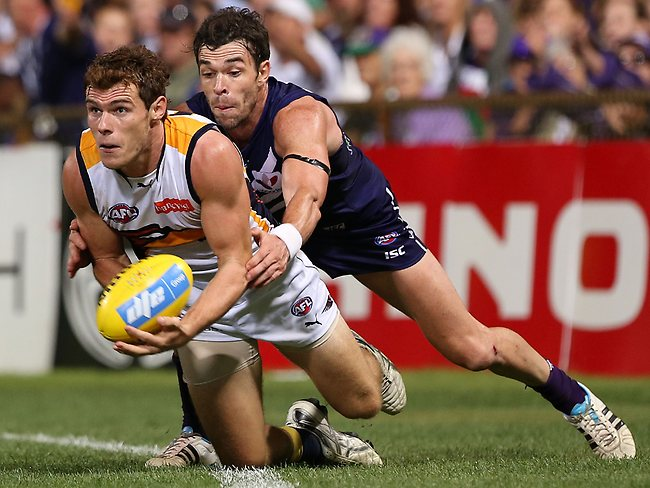PERTH, AUSTRALIA - MARCH 23: Luke Shuey of the Eagles is tackled by Ryan Crowley of the Dockers during the round one AFL match between the Fremantle Dockers and the West Coast Eagles at Patersons Stadium on March 23, 2013 in Perth, Australia. (Photo by Paul Kane/Getty Images)