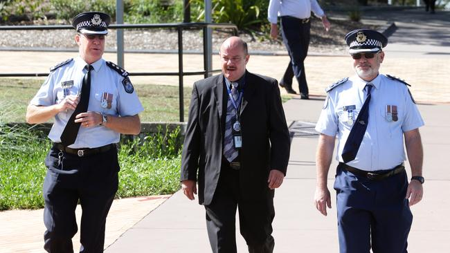 nspector Lee Jeffries (left) and inspector Peter Doyle (right) arrive with fellow police officers at the Memorial Service for Detective Inspector Rod Kemp, The Chandler Theatre, Chandler. Photographer: Liam Kidston.