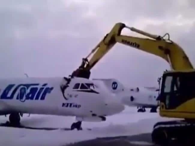 The excavator grab easily slices through the top of the jet.